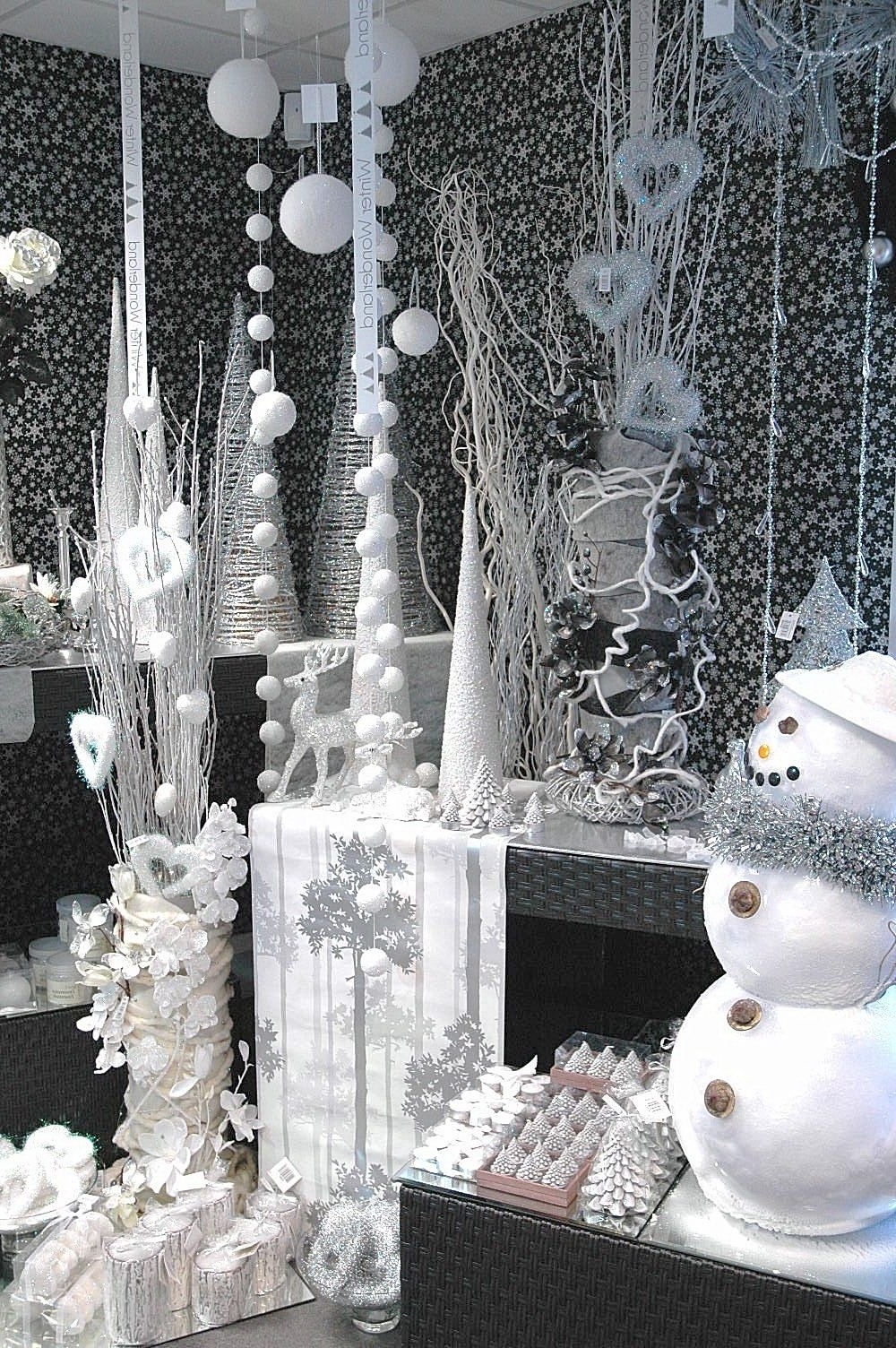 A Winter Wonderland Display Similar To Elf And White