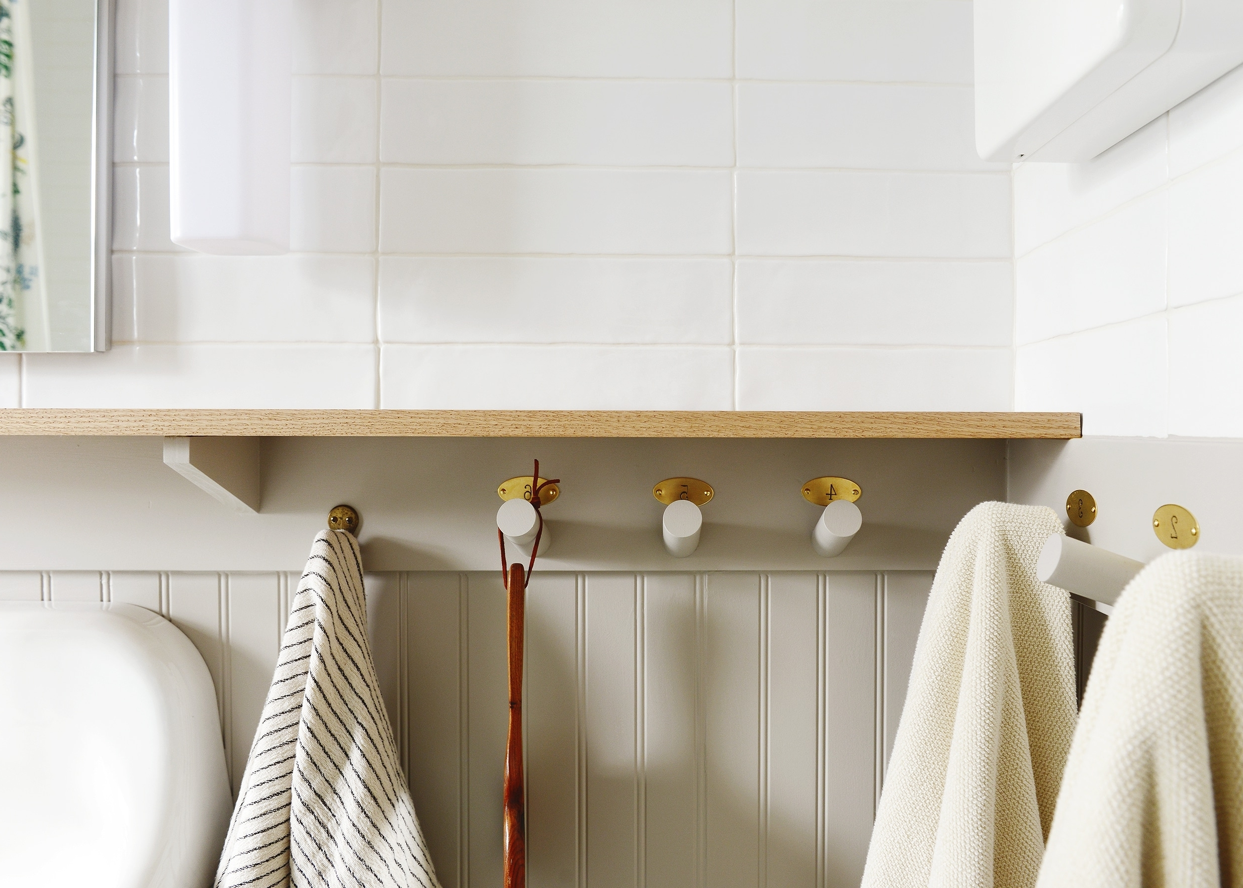 Our Diy Beadboard Wall Treatment With Hooks + Countertop Using Beadboard In A Small Bathroom