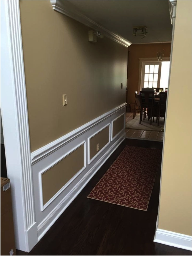 Paint Finishes For Every Room | George Schneider Painting Eggshell Paint In Living Room