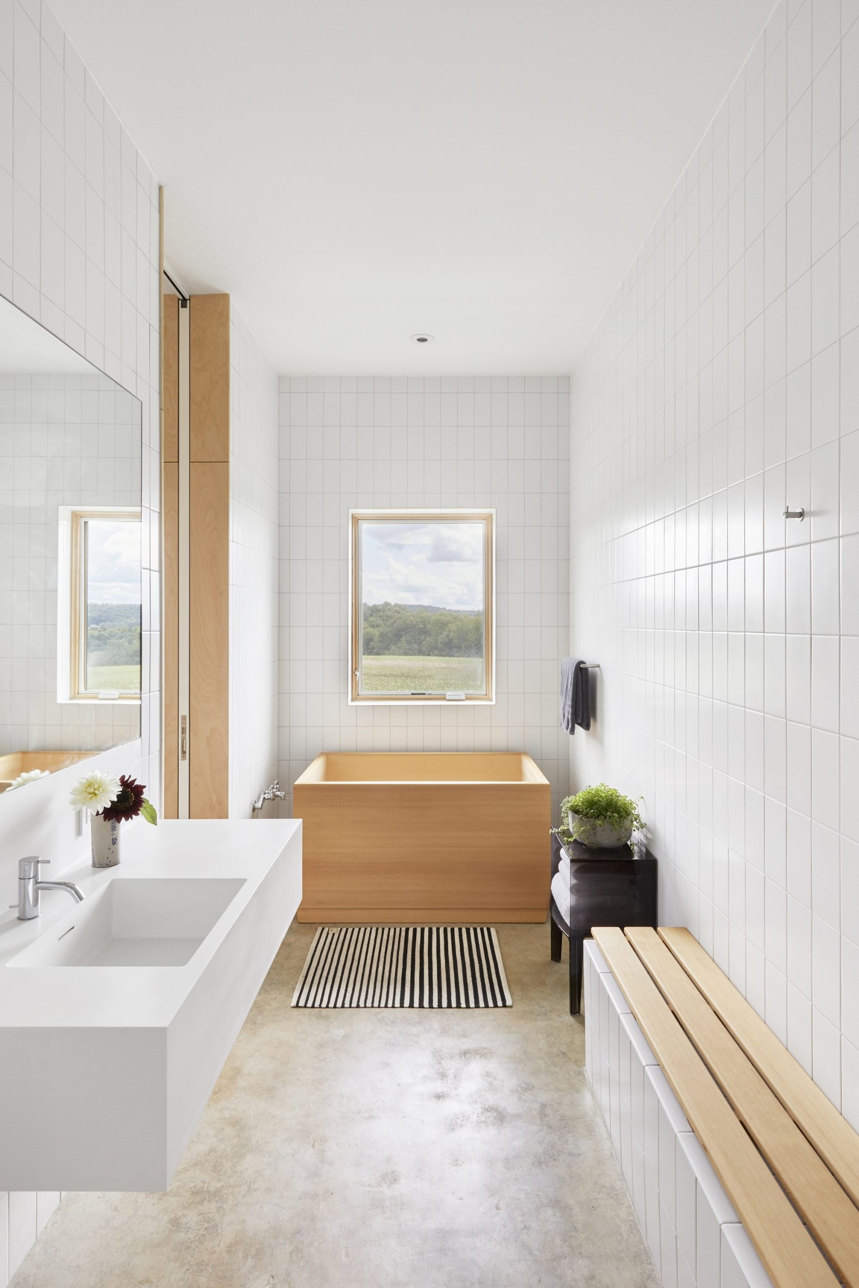 White Tiled Bathroom With A Wooden Bathtub And A View Of The 20+ Bathroom Design Livingston Inspirations